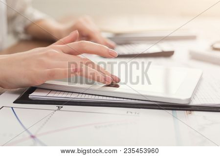 Closeup Of Woman Hands Using Digital Tablet And Counting On Calculator. Financial Background, Count