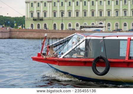 Russia, Saint Petersburg - August 18, 2017: Pleasure Excursion Boat With Tourists Walking Along The