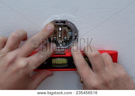 Close Up Of Electrician Man At Work On Switches And Sockets Of A Residential Electrical System.