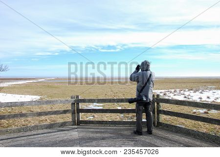 Birdwatcher On A Wooden Platform By The Great Grassland At Ottenby At The Swedish Island Oland In Th