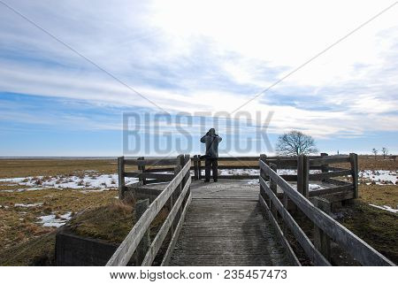 Birdwatcher By The Famous Birdwatching Site At Ottenby On The Swedish Island Oland In The Baltic Sea