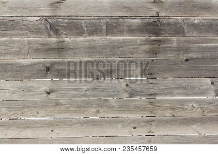Rustic Wooden Fence With Horizontal Boards With Knots And Nails