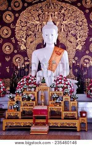The Buddha Is Not The World.the Buddha Does Not Forget The World.