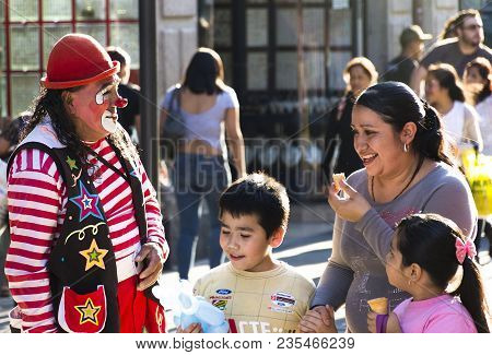 Mexico City , Mexico, - August 13, 2016: A Mom Buying A Dog Shape Balloon To Her Son In Madero Stree