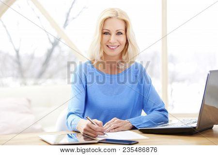 Confident Mature Businesswoman Portrait With Laptop