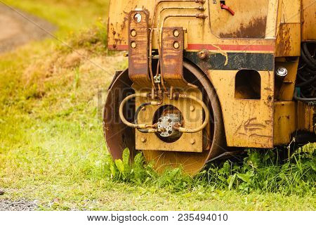 Agriculture, Harvesting, Gardening Machinery Concept. Combine Harvester Standing Next To Coutryside