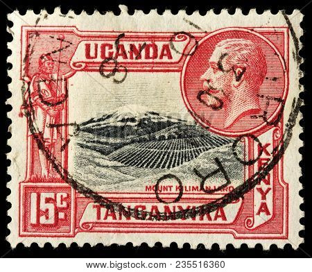 Luga, Russia - February 8, 2018: A Stamp Printed By East African Community Shows Portrait Of King Ge