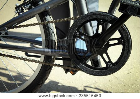 Bicycle Part With Wheel, Gear, Chain And Pedals Close Up