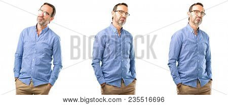 Middle age handsome man with sleepy expression, being overworked and tired over white background
