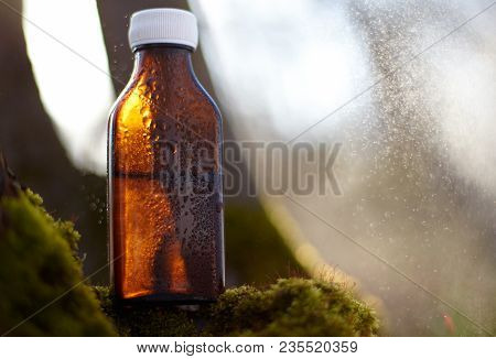 Natural Remedies - Medicines. A Dark Bottle With A Natural Remedy.