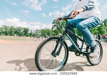 A Man Rides A Mountain Bike On A Sunny Summer Day. Hipster Rides A Bike In The Park.