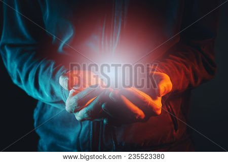 Hope, Faith And Spirituality. Light In Cupped Male Hands.