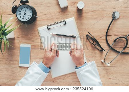 Male Doctor Holding Unlabeled Generic Tablets And Medication, Generic Drugs Concept, Prescription Me