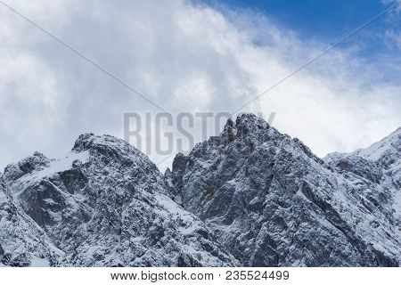 Close-up Of Amazing Snowy Mountains And Glaciers Surrounded By White Clouds In The Bavarian Alps. Vi