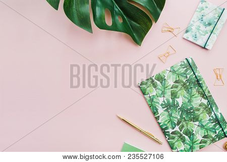 Exotic Tropical Monstera Palm Leaf And Home Office Stationery On Pale Pink Background. Flat Lay, Top