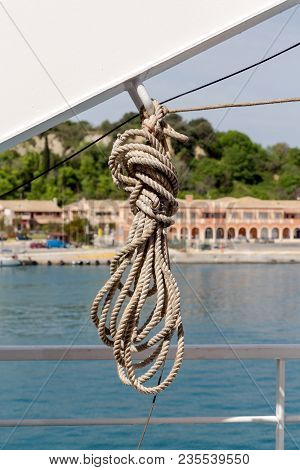 Mooring Rope On The Ship Hanging Close-up Against The Coastline