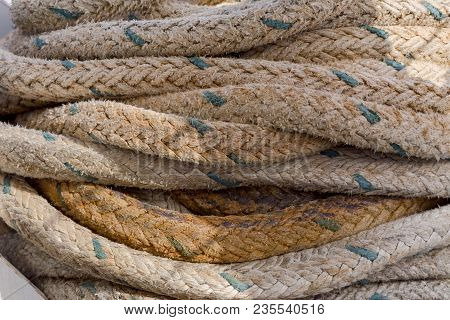 Folded, Old Mooring Cable For Fixing The Vessel To The Berth Or Board Of Another Ship Close-up