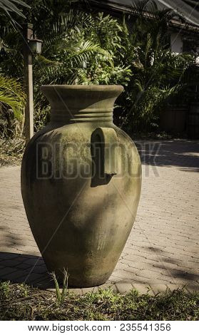 Large Decorative Terra Cotta Container On An Outdoor Patio, Florida