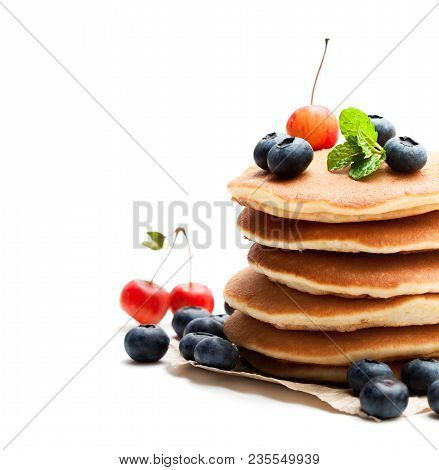Stack  Of Scotch Pancakes With Fresh Blueberry And Wild Apples Isolated On White
