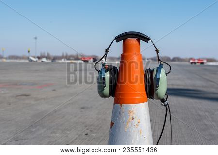Headphones Aircraft Technician, Who Conducts Preflight Preparation Of The Aircraft, Are Put On An Or