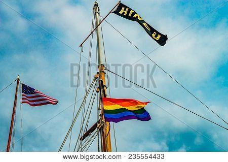 Three Flags On Yachts Masts In Provincetown' Marina, Massachusetts