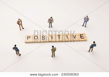 Miniature Figures Businessman : Meeting On Positive Word By Wooden Block Word On White Paper Backgro