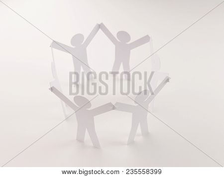 Closed Joining Of Six  Paper Figure In Hand Up Posture On Bright White Background. In Concept Of Bus