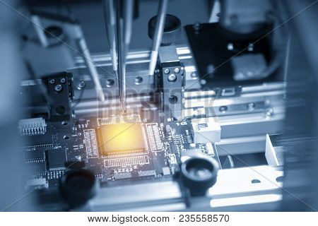 The Microchip On The Main Board In The Assembly Line In The Light Blue Scene With Lighting Effect, C