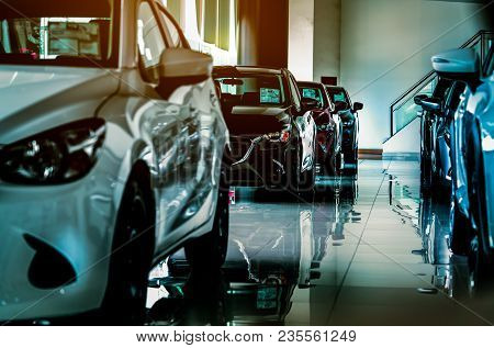 New Luxury Compact Car Parked In Modern Showroom For Sale. Car Dealership Office. Car Retail Shop.