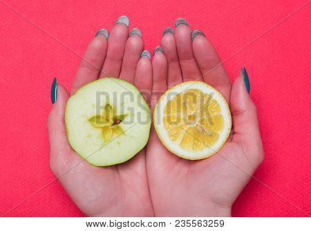 Halves Of Fruit Lying On Hands