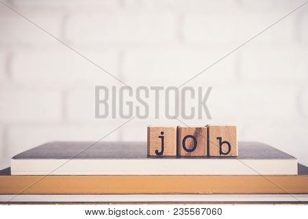 The Word Job, Alphabet On Wooden Cubes On Top Of Books. Background Copy Space, Minimal. Job Applicat