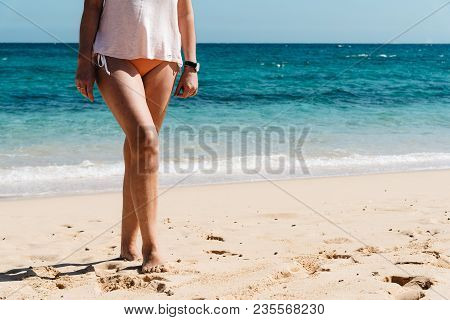Beach Vacation Travel, Woman Legs Closeup Standing On White Sand Relaxing In Beach Wearing Bikini Sw