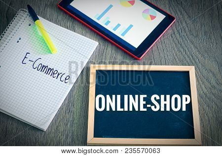 Plate With The Inscription Webshop And E-commerce With A Tablet Graphs And Statistics And Block To I