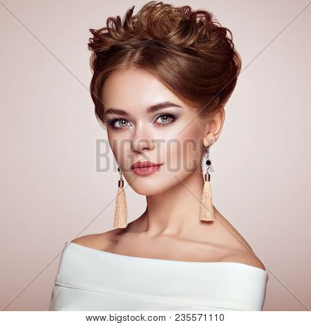 Brunette Woman With Elegant And Shiny Hairstyle. Beautiful Model Woman With Curly Hairstyle. Care An