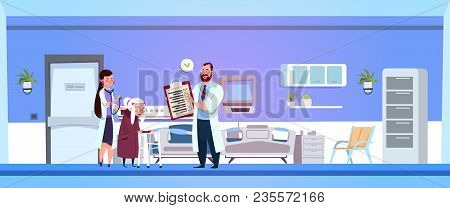 Doctor And Nurse Discuss Prescription For Old Woman In Hospital Ward Clinic Room Interior Background