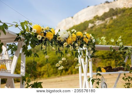 Happy Outdoor Ceremony Scene For A Summer Mountain Wedding. Wed Aisle, Decorated Alter And Flower De