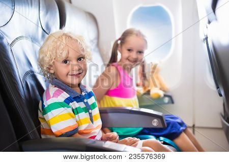 Kids Flying Airplane. Fligh With Children.