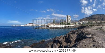 Rocky Coast Near The Resort Los Cristianos On The Island Tenerife, Canary Islands, Spain