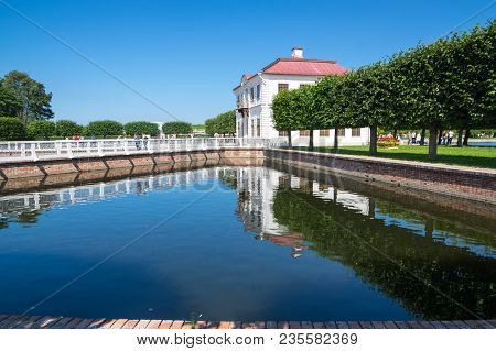 Saint- Petersburg, Russia - July 11, 2016: Marly Palace And Sectoral Ponds In Lower Park Of Petrodvo