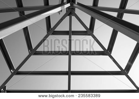 Structure Of Steel Roof Frame For Building Construction.black And White Photo.
