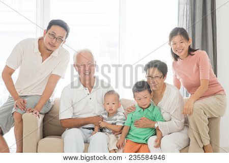 Happy Asian family at home, portrait of multi generations indoor lifestyle.