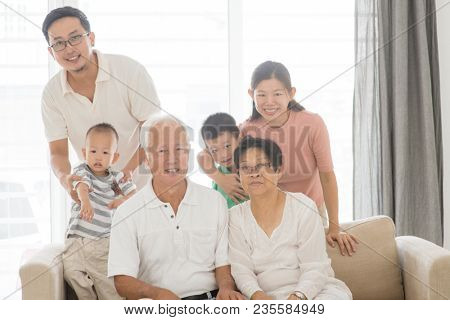 Happy Asian family portrait at home, multi generations indoor lifestyle.