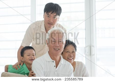 Happy Asian family at home, portrait of multi generations people indoor lifestyle.