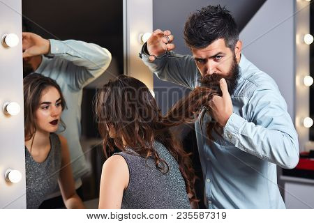 Male Hairdresser Cutting Hair, Does A Hairstyle Of Girl Client. Hairstylist Serving Client At Barber
