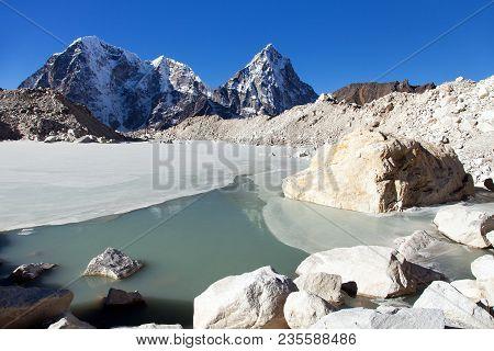 View From Khumbu Glacier, Lake On Glacier, Mounts Arakam Tse, Cholatse, And Tabuche Peak, Khumbu Val