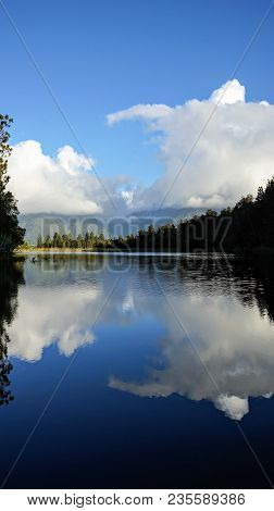 Beautiful Sunset View Of Lake Matheson, Famous For Its Reflected Views Of Mt. Cook And Mount Tasman,