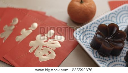 Chinese red jujube cake and red packet with word mean luck for lunar new year