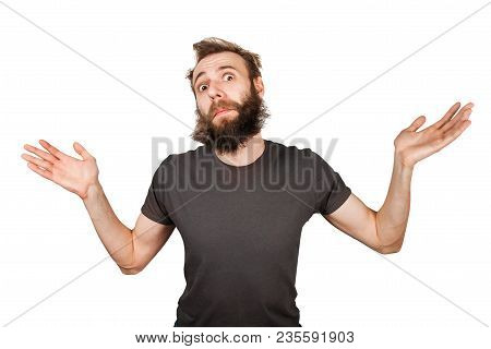 Young Bearded Man Shrugs His Shoulders. Isolated On White.
