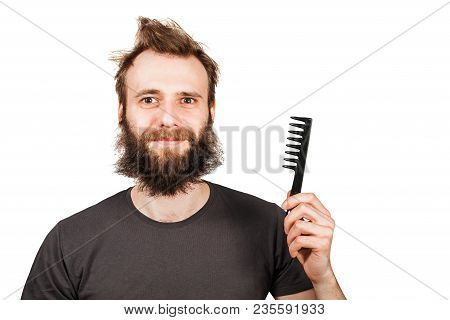 Young Bearded Overgrown Man Holding Comb. Isolated On White.