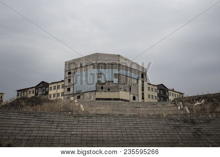 Outskirts. Abandoned construction. Unfinished building. Grunge landscape. Urban grunge. Grunge style. Grunge architecture.  Grunge building.